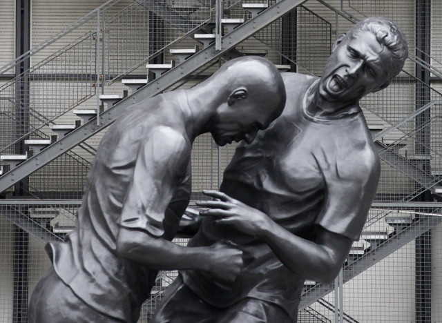 A statue depicting former French national soccer team player Zidane's head-butt on Italian defender Materazzi during the 2006 final of the soccer World Cup is seen in front of the Centre Pompidou modern art museum in Paris
